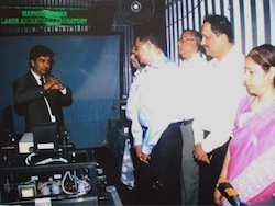 Manick Sorcar demonstrates laser equipment to officials at Javapur University